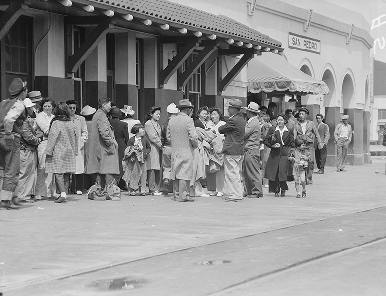 People with Japanese Ancestry await forced transportation and relocation at San Pedro Pacific Electric Station