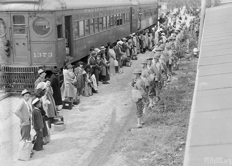 Terminal Island resident Japanese Americans face Army guards at Santa Anita Race Track