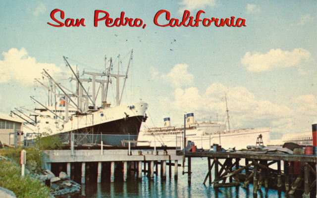 Freighter at dockside in Los Angeles Harbor, San Pedro, California. In the background is the U.S. Lurline departing for Hawaii